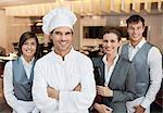Portrait of smiling restaurant employees