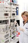 Genetics research. Researcher using a High pressure liquid chromatography (HPLC) machine.