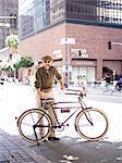 Man with Bicycle Smoking Pipe