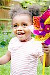 Smiling girl playing with pinwheel