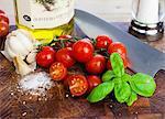 Cherry tomatoes, basil, salt, garlic and olive oil