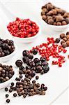 Allspice berries, pink pepper, juniper berries and black peppercorns