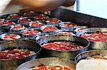 Unbaked tomato focaccia in baking tins