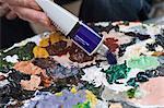 Artist squeezing acrylic Paint
