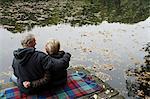 senior couple sitting lakeside