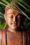 Closeup of wooden Buddha's face.