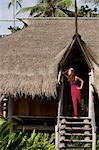 woman standing in doorway of island house