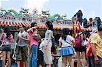Visitors at Pak Tai Temple during the Bun festival, Cheung Chau, Hong Kong