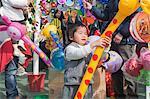 Boys playing with the balloons at the fllower market, Tsuen Wan, Hong Kong