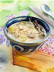 Almond milk soup with porridge,grapes,cinnamon and coconut