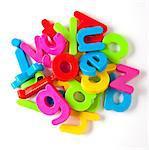 Alphabet fridge magnets in a pile