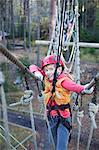 Girl on rope bridge, portrait