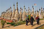 Pa-Oh women entering the Kakku pagoda on festival day, Kakku, Southern Shan State, Myanmar (Burma), Asia