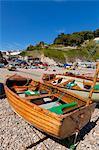 Small fishing boats on the pebble beach, Beer, a small fishing village on the Devon Heritage Coast, Jurassic Coast, UNESCO World Heritage Site, Devon, England, United Kingdom, Europe