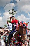 Man wearing Vlcnov folk dress during Ride of the Kings festival calling out verses supporting king, Vlcnov, Zlinsko, Czech Republic, Europe