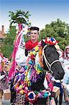 Man riding horse and wearing folk dress during festival Ride of the Kings, Vlcnov, Zlinsko, Czech Republic, Europe