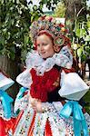 Woman wearing Vlcnov folk dress during The Ride of the Kings festival, Vlcnov, Zlinsko, Czech Republic, Europe