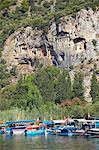 Lycian tombs of Dalyan with fishing and tourists boats below, Dalyan, Anatolia, Turkey, Asia Minor, Eurasia