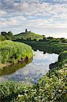 River Tone meandering towards Burrow Mump and the ruined church on its summit, Burrowbridge, Somerset, England, United Kingdom, Europe