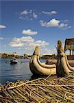Aymara girl in a rowboat, Uros Island, Lake Titicaca, peru, peruvian, south america, south american, latin america, latin american South America
