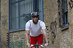 Man bicycling on city street
