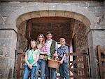 Farmer posing with family by barn