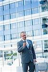 Businessman using Cell Phone, Niederrad, Frankfurt, Germany