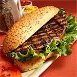 Grilled Steak Sandwich on a Sesame Seed Bun with Lettuce