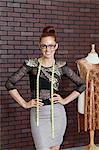 Portrait of beautiful female fashion designer standing hands on hips