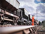 Railway workers signaling train