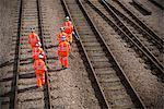 Railway workers walking on train tracks