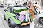 Woman loading shopping bags in car