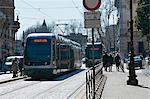 Light rail cars on a sunny Trastevere street