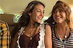 Two female friends in backseat of car