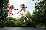 Two girls on trampoline