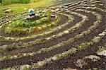Woman meditating in stone labyrinth