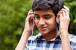 Teenage boy listening to music