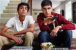 Teenage boys watching television