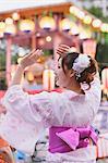 Japanese woman in Yukata dancing