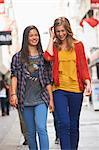 Teenage girls walking in city