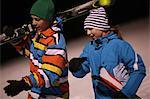 Boys and girls on ski slope at night