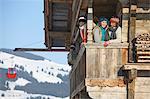 Family at balcony at ski resort