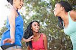 Smiling women playing outdoors