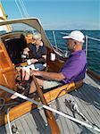 Older couple sailing together on ocean