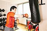 Man using punching bag at gym
