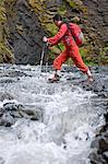 Woman hiking rocky river