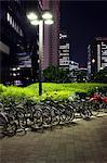 Bicycles + Motorbike parked under street light