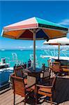 Chairs and Sun Umbrellas on Dock at Bar, Palm Beach, Aruba, Leeward Antilles, Lesser Antilles, Caribbean