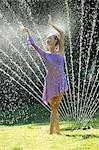 Ballerina in water sprinkler
