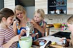 Four girls baking in kitchen